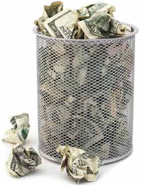 Money thrown in the trash can