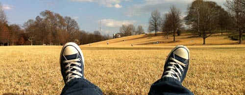 Laying on ground in park